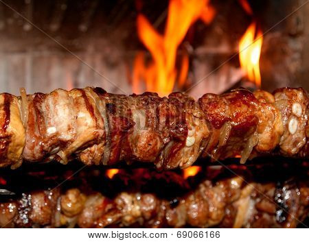 Spit Roast With Meat Cooked On A Spit In The Fireplace 1