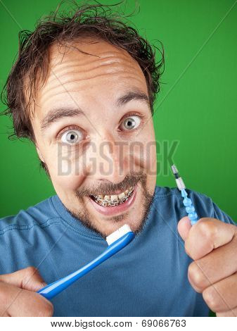 Thirty Year Old Man With Braces And A Toothbrush