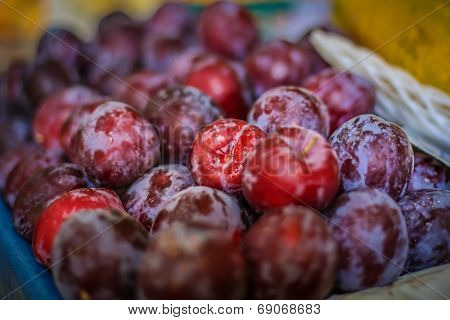 Bunch Of Plums At A Farmer's Market