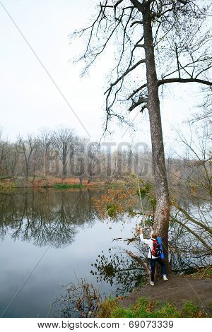 Girl Hiker With Bungee In The Hands Near Autumn River
