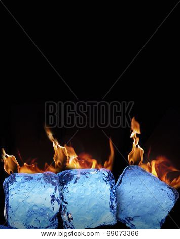 Burning ice cubes on black background