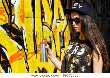Street, outdoor. Attractive teen in a cap