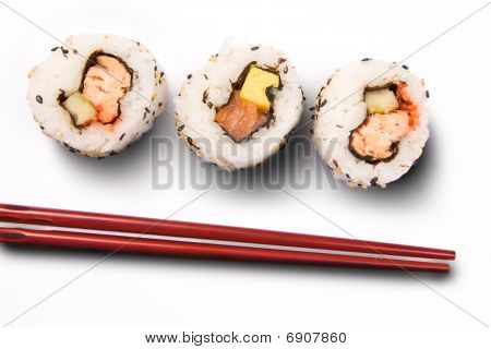 Uramaki sushi with sticks on a white background