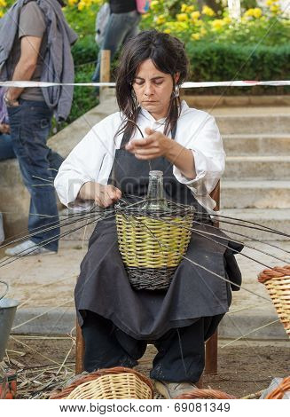 A Woman Showing The Craft Of Basket-making