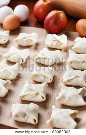 Delicious apple turnovers with baking ingredients