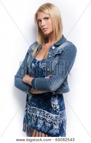 Young beautiful happy blond girl wearing blue jacket.