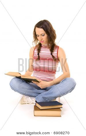Woman Sitting On The Floor And Reading