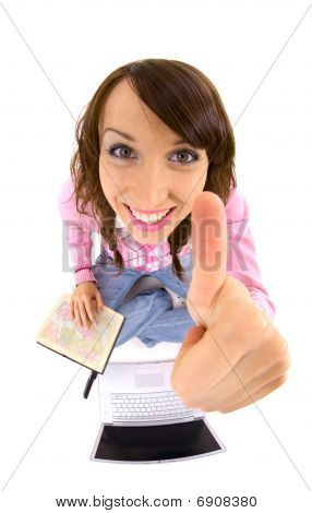 Woman With Atlas And Laptop Showing Thumbs Up