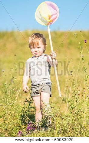 Boy Catches A Butterfly