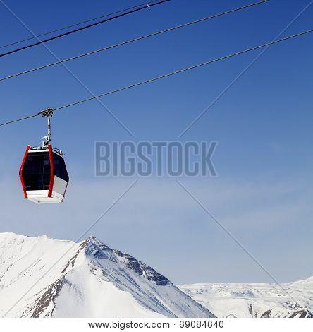 Gondola Lift And Snowy Mountains