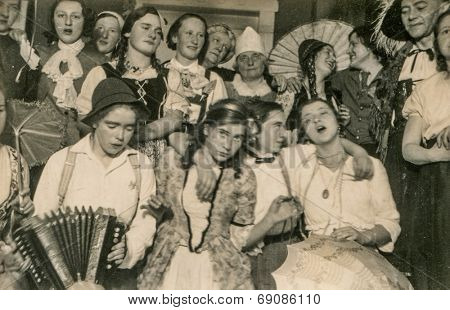 GERMANY, CIRCA FORTIES - Vintage photo of group of people during a costume party