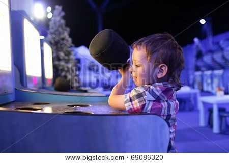 Boy Playing In The Games Attraction