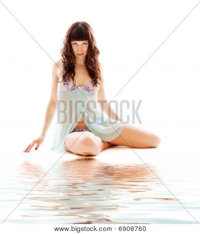 Young Beautiful Woman Sitting
