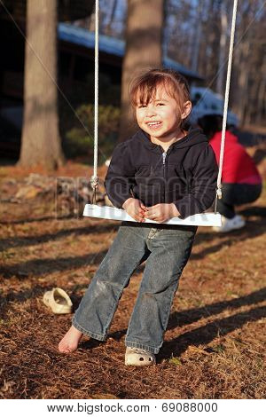 Three-year Old Girl On A Swing