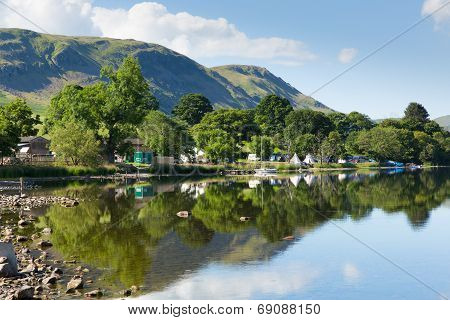 Campsite tents Ullswater Lake District Cumbria England UK with mountains and blue sky