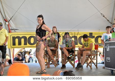 FARO - JULY 19: Tatoo competition awards at the XXXIII - International Motorcycle Meeting in Faro, Portugal, July 19, 2014
