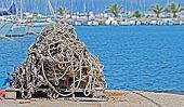 stock photo of fishnet  - an old grey fishnet by the shore  - JPG