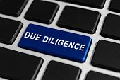 image of diligent  - due diligence blue button on keyboard business concept - JPG