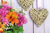 pic of wooden crate  - Flowers composition in crate with decorative heart on wooden background - JPG