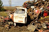 stock photo of scrap-iron  - Large pile of old steel at a metal recycling scrap yard - JPG