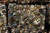 stock photo of junk-yard  - Block of recycled aluminum and tin can at a metal scrap recycle yard - JPG