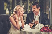 pic of propose  - Man holding box with ring making propose to his girlfriend - JPG