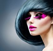 Постер, плакат: Fashion Brunette Model Portrait Hairstyle Haircut Professional Makeup False pink feather Eyelash