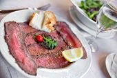 stock photo of chateaubriand  - Well roast beef thinly sliced - JPG