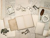 pic of vintage antique book  - vintage writing accessories glasses keys open book old papers letters and photo frames - JPG