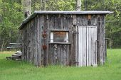 stock photo of log cabin  - Hunting shack in northern part of lower Michigan - JPG