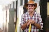 foto of stable horse  - portrait of happy horse breeder inside stable - JPG