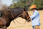 pic of feeding horse  - cowboy feeding his horse out of hand - JPG