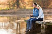 picture of ponds  - peaceful young couple fishing by the pond in autumn - JPG