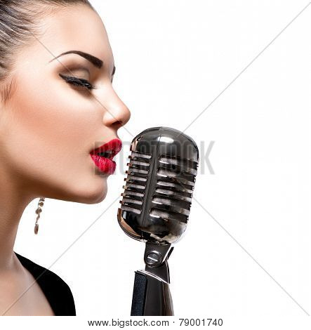 Singing Woman with Retro Microphone. Beauty Glamour Singer Girl Portrait. Isolated on White Background. Vintage Style. Karaoke Song