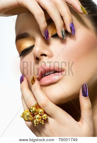 Fashion sexy Beauty model. Manicure and Make-up. Nail Art. Beautiful Woman With Colorful Nails and Luxury Makeup. Beautiful Girl Face and Hands