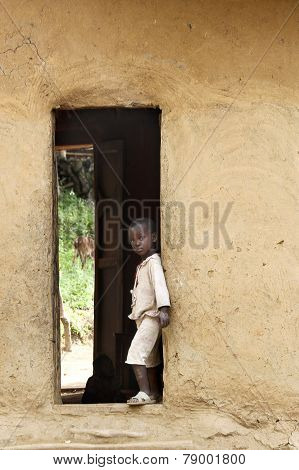 Boy In A Doorway