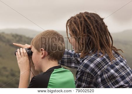Two youth looking for Wildlife.