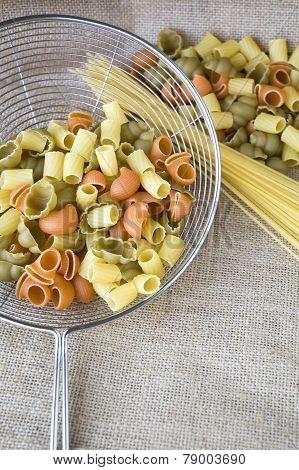 Uncooked Pasta In Colander