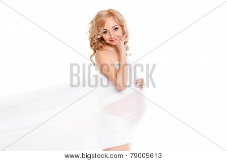 Portrait of a beautiful pregnant woman in white chiffon shawl