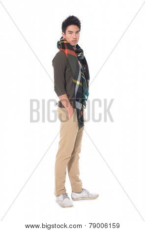 Full body handsome young man with a scarf standing on white background