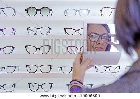 Trying On Glasses With A Small Mirror