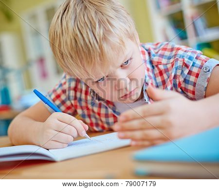 Dishonest learner looking at crib on his palm at lesson