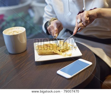 Young Lady Eating Breakfast In Coffee Shop