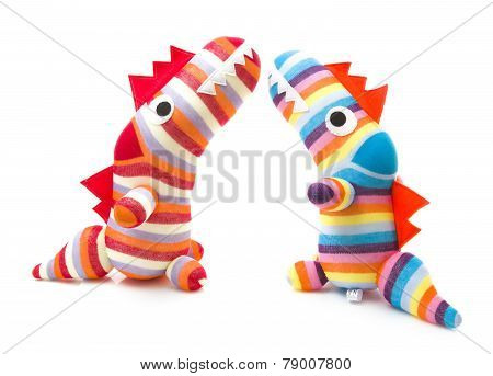 Hand Made Dinosars On A White Background