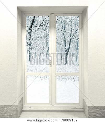 Closed White Door on Wall and cold weather with snow outside the door