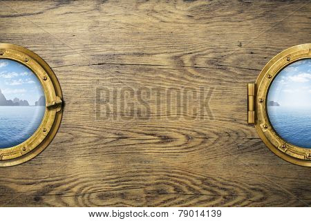 Two ship windows or portholes with tropical sea or ocean island. Travel and adventure concept.