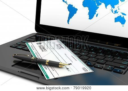 Blank Banking Check And Fountain Pen Over Laptop Keyboard