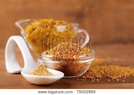 Composition of different kinds of mustard on color wooden background