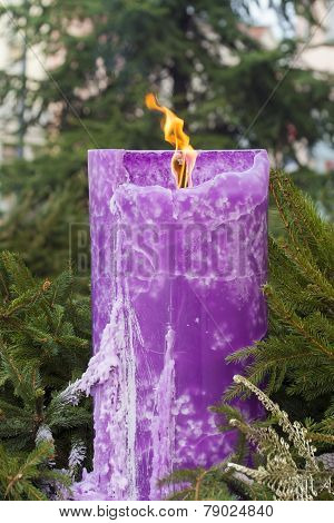 Burning Candle On A Christmas Wreath