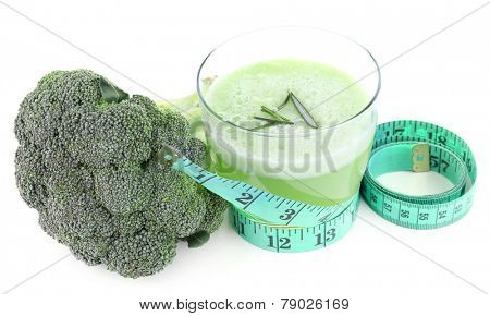 Glass of fresh green juice with centimeter and broccoli isolated on white